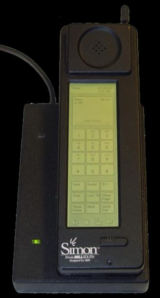 IBM Simon - The Simon Personal Communicator shown in its charging base