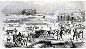 Refrigeration - Ice harvesting in Massachusetts, 1852, showing the railroad line in the background, used to transport the ice.