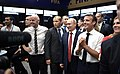 Infantino, Putin, and Macron in the French locker room at Luzhniki.jpg