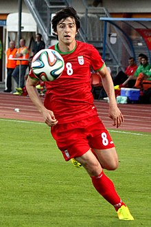 cd277fb19 Azmoun playing for Iran in a 2014 friendly match against Montenegro