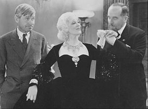 Irene Rich - Rich with Will Rogers and Theodore Lodi in Down to Earth, 1932