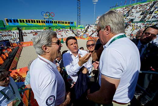 Italian Prime Minister Renzi Speaks With Secretary Kerry As They Watch An Olympic Men's Beach Volleyball Game (28727976011).jpg