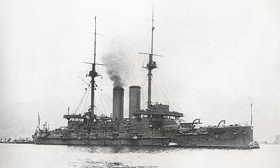 The Japanese battleship Mikasa as she appeared in early February, 1905. One of the most advanced pre-dreadnoughts of the time, she was adapted from the Royal Navy's Majestic-class battleship, but improved with more displacement, speed, two additional guns, and Krupp armour. After fighting in several battles (such as the Yellow Sea and Tsushima), she was sunk after a fire on 11 September 1905, repaired and recommissioned in 1908 only to run aground during the Siberian Intervention in 1921. Today, she is a museum ship in Yokosuka.