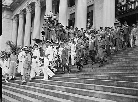 The Japanese delegation leaves the Municipal Building after the surrender ceremony on 12 September 1945 - Japanese occupation of Singapore