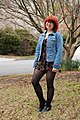 Jean Jacket with a Black Floral Romper, Black Tights, and Cutout Boots.jpg