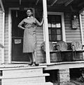 Jeanette Brown Adams FERGUSON, mother of Delois Marie JOHNSON, on porch of house at 332 South Street, Raleigh, NC, 1957. Jeanette worked at the Sandwich Shop on Wilmington Street for 22 years and (26454523052).jpg