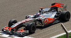 Jenson Button driving for McLaren during a practice session in Bahrain (2010). Image: Andrew Griffith w. Chubbennaitor.