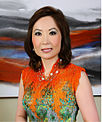 Jing Ulrich orange top.jpg