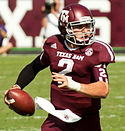 A picture of Johnny Manziel while holding a football during a game.