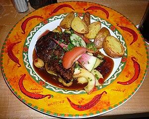 English: Kangaroo steak with glazed apples, cr...