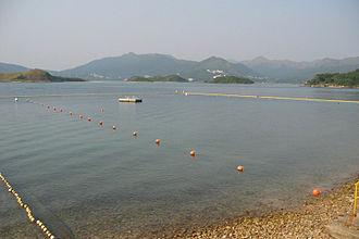 Inner Port Shelter - View from Kiu Tsui Beach of Sharp Island. Pak Sha Chau, Cham Tau Chau and Tai Tsan Chau are visible.