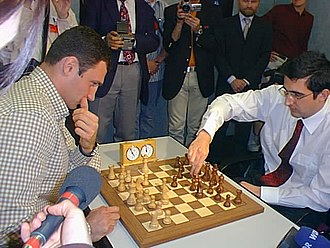 Vladimir Kramnik - Vladimir Kramnik (right) playing chess with Vitali Klitschko, Dortmund, 2002.