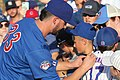 Kris Bryant signing autographs during his rehab assignment against Omaha (44267158662).jpg