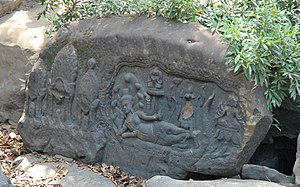 Kbal Spean - Lord Vishnu in a reclining repose lying on the serpent god Ananta, with Goddess Lakshmi at his feet and Lord Brahma on a lotus petal, in Kbal Spean River bank