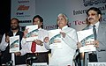 Lalu Prasad, the Minister of State for Railways, Shri Naranbhai J. Rathwa, the chairman railway board.jpg