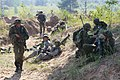 Lithuanian soldiers and U.S. Soldiers take a break after seizing a trench line during Saber Strike 2013 June 7, 2013, in Adazi, Latvia 130607-O-ZZ999-006.jpg