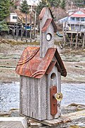 Locked and clocked birdhouse Alaskan coast village.jpg