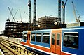 London Docklands Light Railway with tower cranes but where? August 1989.jpg