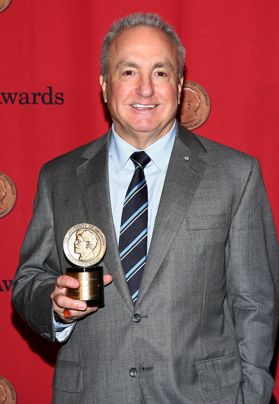 Lorne Michaels holding a Peabody Award at the 2013 Peabody Award Ceremony