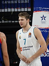 02b93945453 (left) with Real Madrid  (right) guarded by Josh Adams