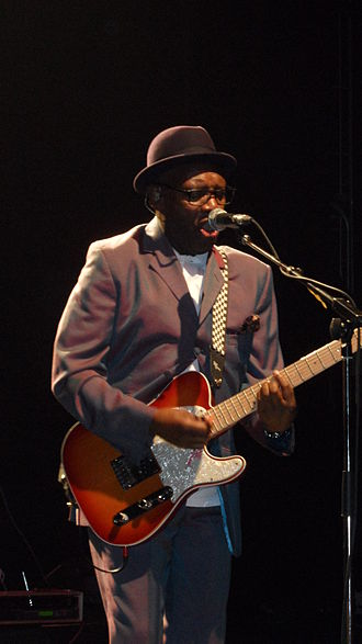 Mohair - Lynval Golding of The Specials wearing a two-tone suit, so called because the mohair fabric changes color from grey to purple