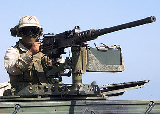 M2 Browning - A U.S. Marine mans a .50 caliber machine gun as part of a security force during a training exercise with the 24th Marine Expeditionary Unit in November 2002.