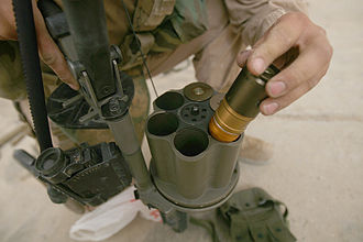 40 mm grenade - A U.S. Marine feeding the Milkor MGL-140 grenade launcher with 40 mm grenades