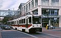 MAX train on Yamhill St with Pioneer Place (1991) - Portland, Oregon.jpg