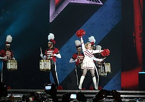 "The MDNA Tour - Madonna and her dancers wearing majorette-inspired outfits performing ""Give Me All Your Luvin'"" during the concert in Berlin, Germany."