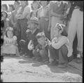 Manzanar Relocation Center, Manzanar, California. Evacuees of Japanese ancestry watching Memorial D . . . - NARA - 538543.tif