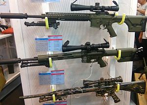 Marine Scout Sniper Rifle - Different generation models of MSSR on display. From top to bottom: Gen 5 (prototype), Gen 4, Gen 3.