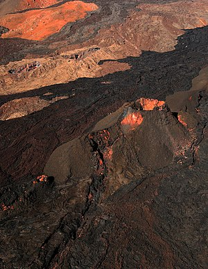A volcanic vent and lava flows from various er...