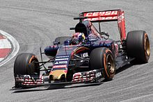 Formula One racing car in motion on a track