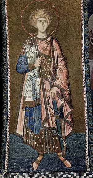 Byzantine dress - A 14th-century military martyr wears four layers, all patterned and richly trimmed: a cloak with tablion over a short dalmatic, another layer (?), and a tunic