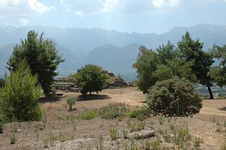Sparta - Hollow Lacedaemon. Site of the Menelaion, the ancient shrine to Helen and Menelaus constructed in the Bronze Age city that stood on the hill of Therapne on the left bank of the Eurotas River overlooking the future site of Dorian Sparta. Across the valley the successive ridges of Mount Taygetus are in evidence.