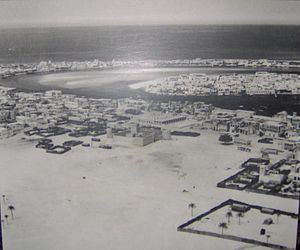 United Arab Emirates - Dubai in 1950; the area in this photo shows Bur Dubai in the foreground (centered on Al-Fahidi Fort); Deira in middle-right on the other side of the creek; and Al Shindagha (left) and Al Ras (right) in the background across the creek again from Deira
