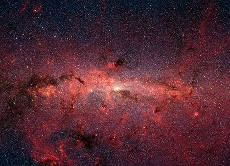 Le centre de la Voie lactée, vu en infra-rouge par le télescope spatial Spitzer de la NASA. En lumière visible, cette région est cachée par une grande quantité de poussière interstellaire.