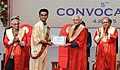 Mohd. Hamid Ansari presenting the gold medal and certificate to a student of the Krantiguru Shyamji Krishna Verma Kachchh University, at Bhuj, in Gujarat. The Governor of Gujarat (1).jpg