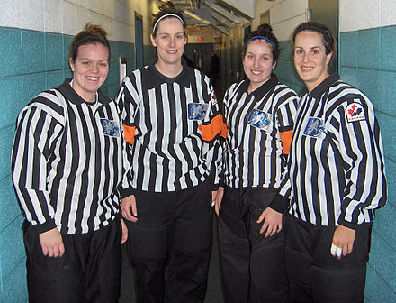 Officials working under a four-official system. Orange armbands are worn by the referees to distinguish them from the lineswomen. Montreal - Burlington 3 decembre 2011 021.jpg