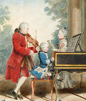 Classical period (music) - Wolfgang Amadeus Mozart (seated at the keyboard) was a child prodigy virtuoso performer on the piano and violin. Even before he became a celebrated composer, he was widely known as a gifted performer and improviser.