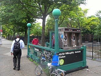 LinkNYC - One of New York City's 9,000 to 13,000 dated payphones at the Myrtle–Willoughby Avenues subway station