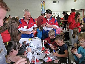 National Association of Rocketry - Two NAR members lead a rocket building session for a group of elementary school students