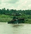 NARA 111-CCV-123-CC43680 UH-1D medevac landing on Armored Troop Carrier My Tho River 1967.jpg
