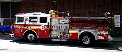 FDNY Engine 6, an older Seagrave pumper which replaced the newer apparatus which was destroyed on 9/11/2001. The names of the four Engine 6 firefighters lost that day are written on the front door.