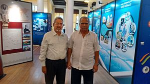 """Ramasamy Palanisamy - An exhibition titled, """"The Rise of Digital India"""" showcasing the rise of India as an Information Technology Superpower was curated by Narayan Ramdas Iyer working for the National Council of Science Museums, India and taken to several destinations in Indonesia and Malaysia in the early part of 2015. Seen here is the Curator with the Deputy Chief Minister of Penang, Ramasamy Palanisamy with the exhibition in the background."""