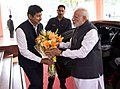 Narendra Modi being received by the Minister of State for Information & Broadcasting, Col. Rajyavardhan Singh Rathore, on his arrival for the Golden Jubilee celebrations of the Press Council of India.jpg
