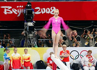 United States at the 2008 Summer Olympics - Nastia Liukin competes on the balance beam during the individual all-around final.