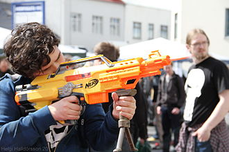 Nerf Blaster - A man aiming an N-Strike Stampede ECS