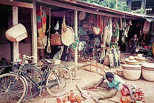 Ikot Ekpene - Section of Ikot Ekpene craft market showing woven raffia products for sale