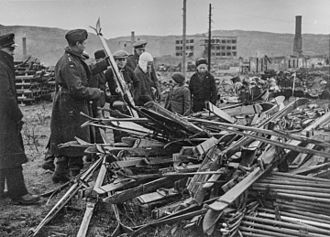 Liberation of Finnmark - Norwegian officers examine skis left behind by retreating German troops in Finnmark